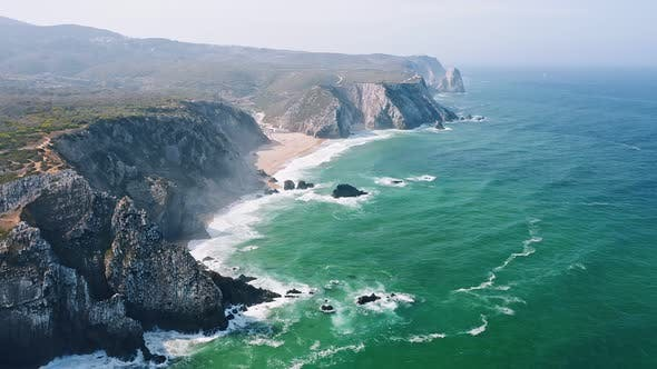 Thumbnail for Aerial View of Rocky Cliff Formation of Praia Grande Beach, Portugal Atlantic Coast. Cabo Do Paco