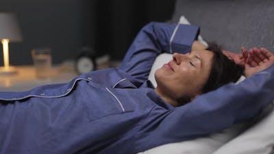 Woman Going to Sleep