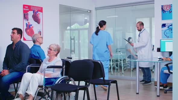 Thumbnail for Doctor Explaining Diagnosis To Nurse in Waiting Area