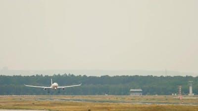 Passenger Plane Landing at the Airport