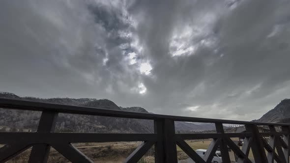 Cover Image for Timelapse of Wooden Fence on High Terrace at Mountain Landscape with Clouds, Horizontal Slider