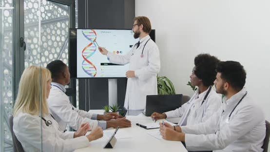 Thumbnail for Doctor which Explaining the Dna Structure for His Concentrated Multiethnic Colleagues