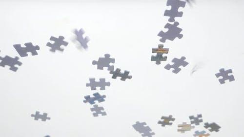 Puzzle Pieces Falling Down. Glass Transparent Background. Pieces of Puzzle Falling Down. Conceptual