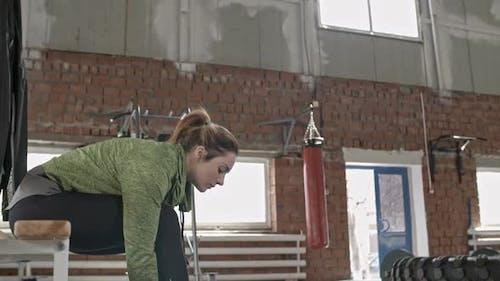 Sportswoman Tying Shoelace
