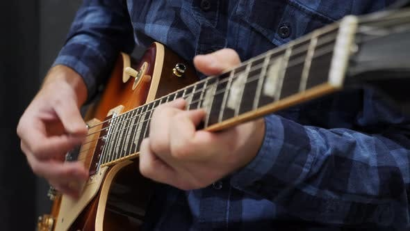 Musician performing solo on guitar