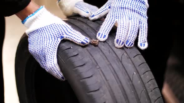 Thumbnail for Auto Mechanics Repairing Wheel Tire with Blowout