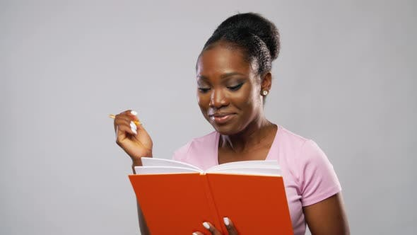 Thumbnail for African American Woman with Notebook