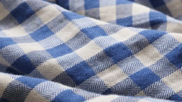 Thumbnail for Blue and white shirt check pattern fabric texture close-up slow tilt 4K 2160p 30fps UHD footage - Ch