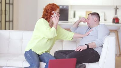 Stressed Worried Caucasian Woman Calling Ambulance As Man Having Symptoms of Heart Attack