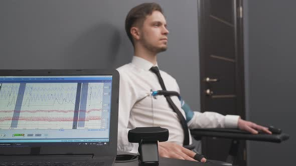 Thumbnail for Bearded Man During Polygraph Test in Grey Office
