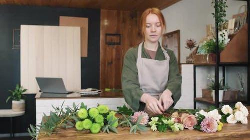 Portrait Of Smiling Female Florist In Flower Shop