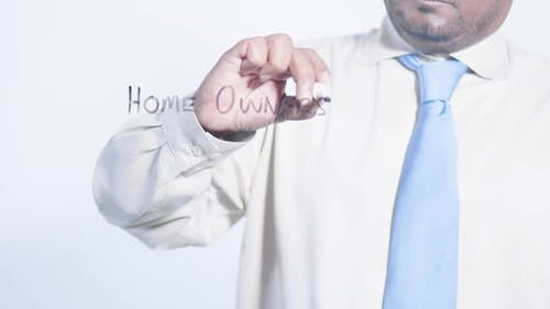 Asian Businessman Writes Home Ownership Pr 1