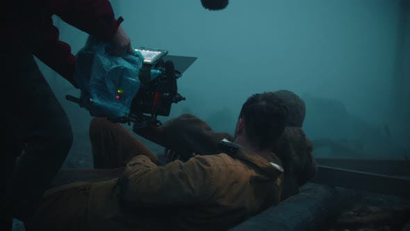 Backstage of Filming - Wounded Soldiers Lying on the Ground in the Misty Forest and Talking