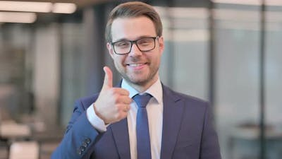 Portrait of Businessman showing Thumbs Up Sign