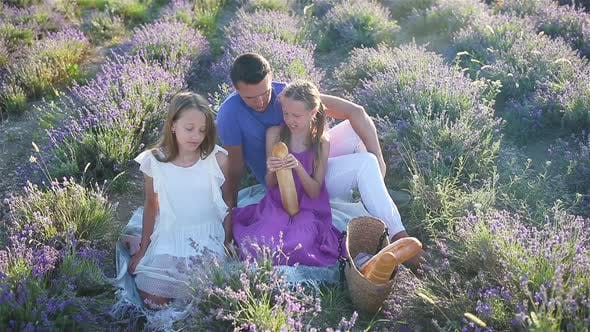 Thumbnail for Family in Lavender Flowers Field on the Sunset