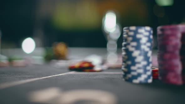 Close Up of Stacks of Generic Poker Chips on a Black Felt Table
