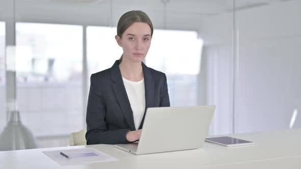Thumbnail for Young Businesswoman Saying Yes By Shaking Head in Office
