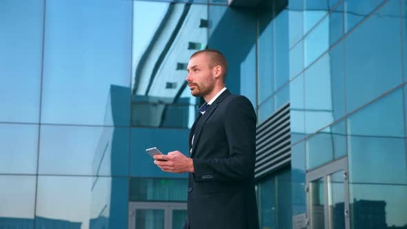 Thumbnail for Young Businessman Using Smartphone Near Office and Celebrating Achievement. Business Man Found Out