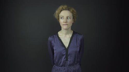 Serious Actress Looks Around and Raises Eyebrows at Audition