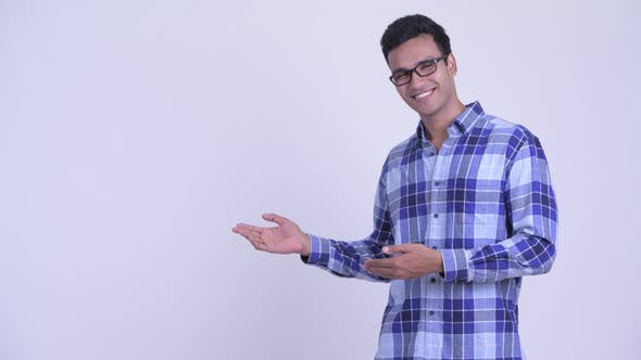 Happy Young Indian Hipster Man Showing Something