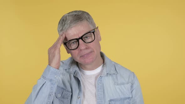 Cover Image for Casual Senior Man with Headache on Yellow Background