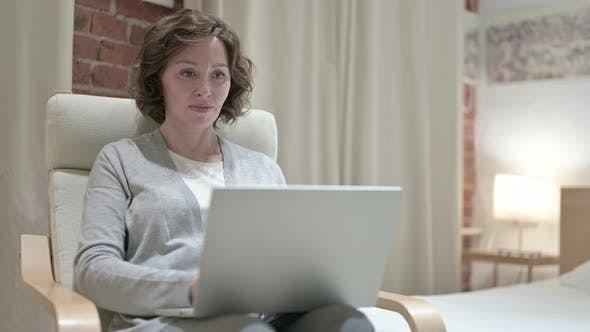 Thumbnail for Old Woman Using Laptop in Bedroom