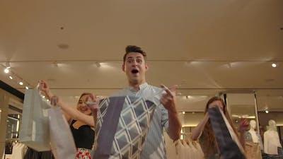 Happy People Dancing in Shop