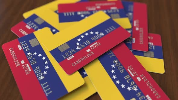 Cover Image for Pile of Credit Cards with Flag of Venezuela