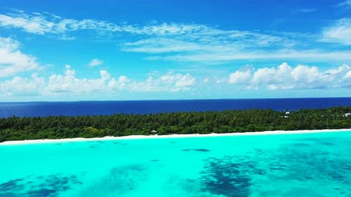 Daytime above abstract view of a paradise sunny white sand beach and blue ocean background in colour
