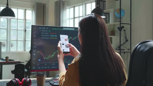 Woman Trader With Financial Stock Market Charts On Desktop Computer And Shopping Online On Mobile