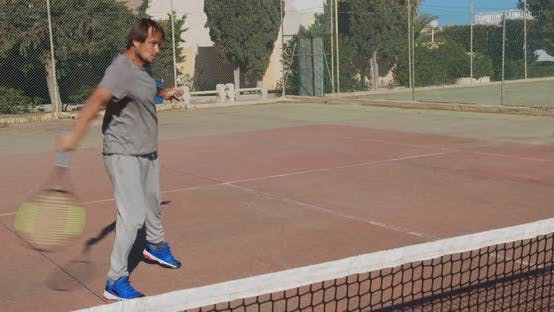 Thumbnail for Male Athlete Playing Tennis on Outdoors Hard Court. Happy Man in Celebration of Success and Win.
