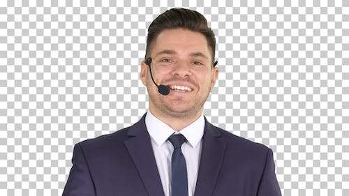Man in formal clother with a headset presenting something