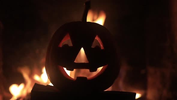 Thumbnail for Halloween Pumpkin with Scary Face on Fire Background