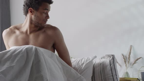 Thumbnail for Man Waking Up and Checking Smartphone