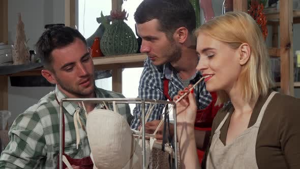 Group of Ceramic Artists Working on a Sculpture Together