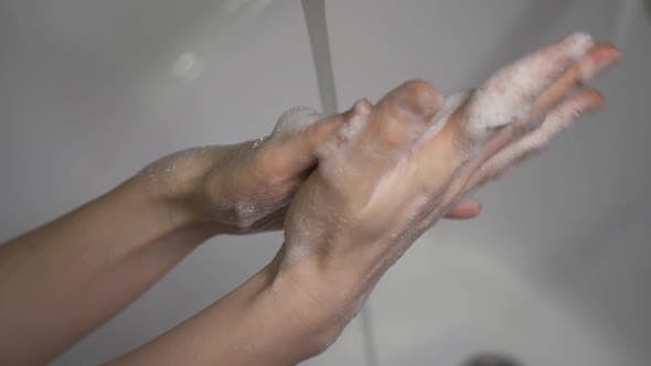 Cover Image for Coronavirus Pandemic Prevention Wash Hands with Soap Warm Water Rubbing Fingers Washing Frequently