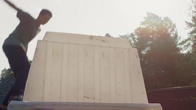 Skater Jumping Over Obstacle in Skatepark