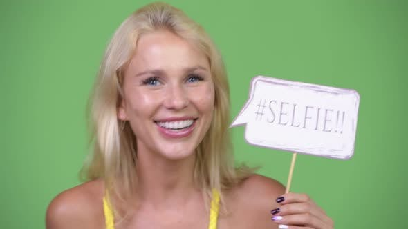 Thumbnail for Young Happy Beautiful Blonde Woman with Selfie Paper Sign