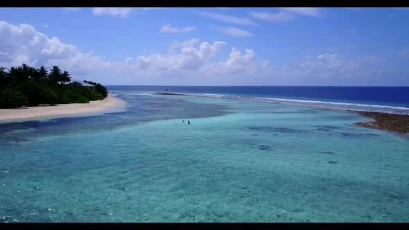 Thumbnail for Aerial top down landscape of idyllic island beach break by shallow ocean with clean sand background