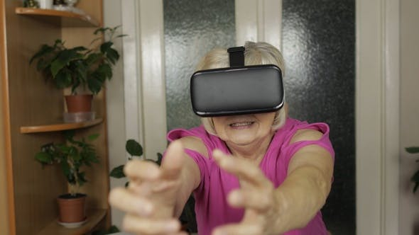 Thumbnail for Senior Grandmother Woman in Virtual Headset Glasses Watching 3d Video in 360 Vr Helmet at Home