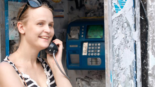 Thumbnail for Attractive Woman Using A Public Telephone
