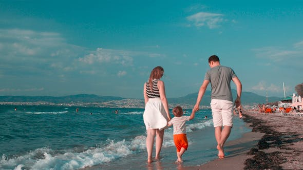 Thumbnail for Happy Family Walking On the Beach In A Summer Day