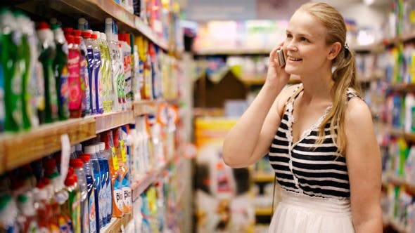 Thumbnail for Woman Chatting On Her Mobile While Out Shopping