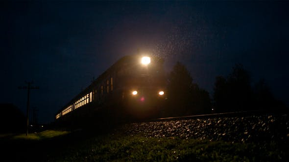 Thumbnail for Train Passing Fast Through A Rural Area By Night
