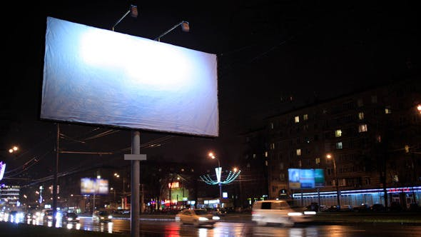 Urban Scene With An Empty Billboard By Night
