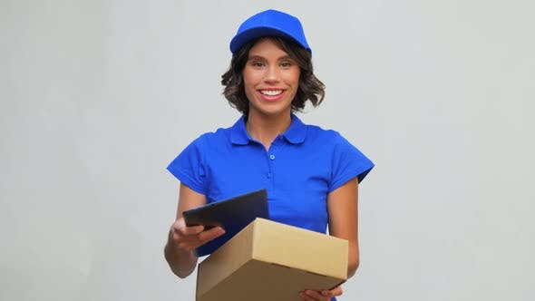 Happy Delivery Girl with Parcel Box and Tablet Pc