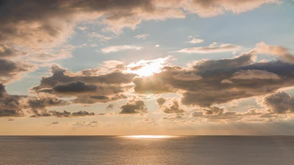 Thumbnail for of Evening Sky with Sky Rays and Clouds Crossing Over the Sea Horizon Idyllic Landscape