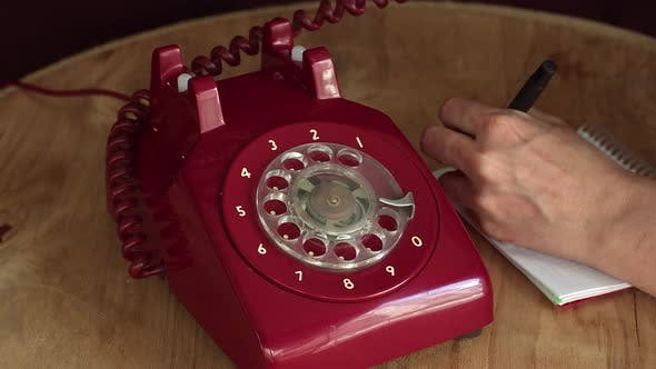 Old Vintage Antique Red Phone Calling And Taking Notes
