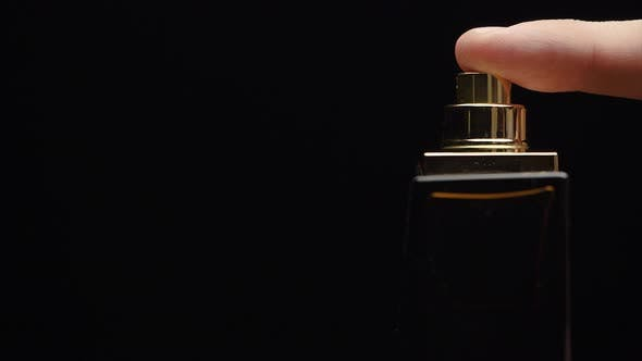 Thumbnail for Fragrance Luxury Bottle Contents In Dark Spraying