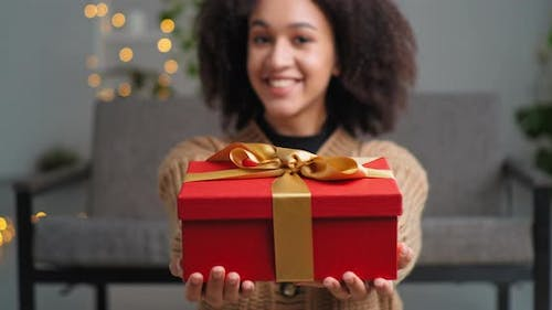 Beautiful Generous African American Woman Ethnic Girl with Red Gift Box Gift Smiles Sincerely